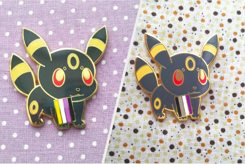 a Umbreon pin with options for Umbreon to hold the nonbinary or asexual pride flag in their mouth