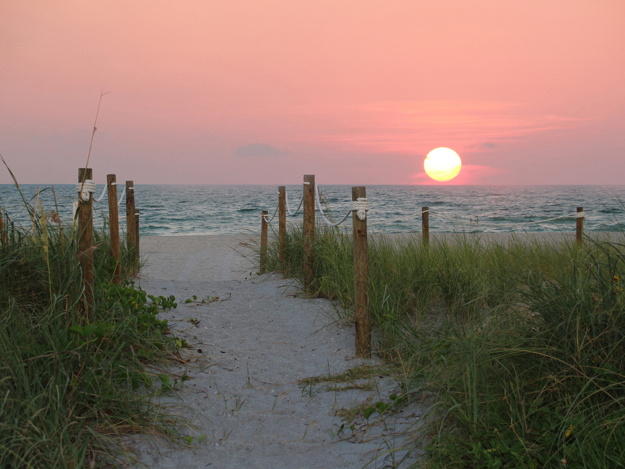 a beautiful sunset and pathway to the beach