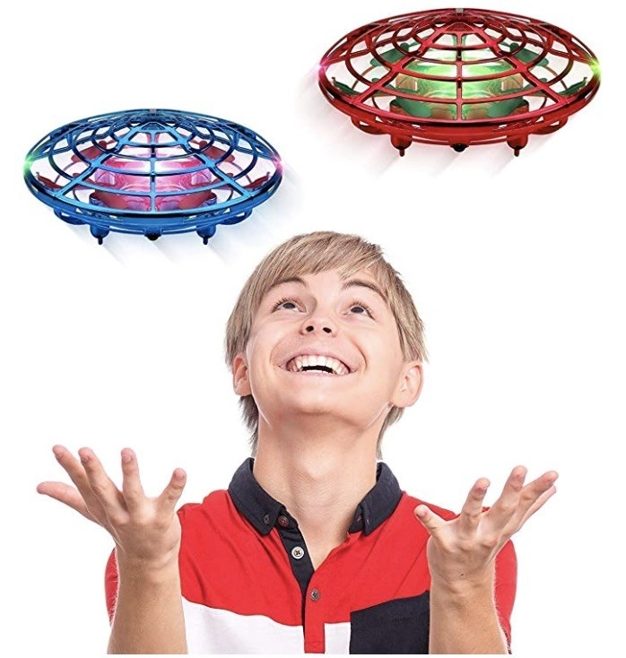 a child playing with drone toys