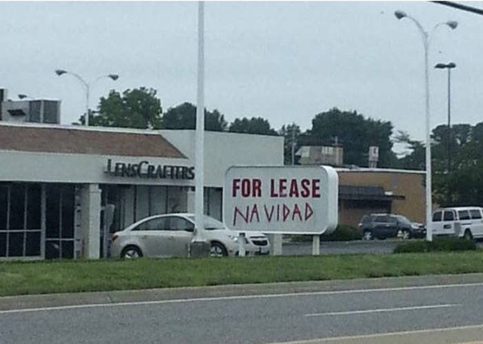 "A ""For lease"" sign with navidad scrawled under it"
