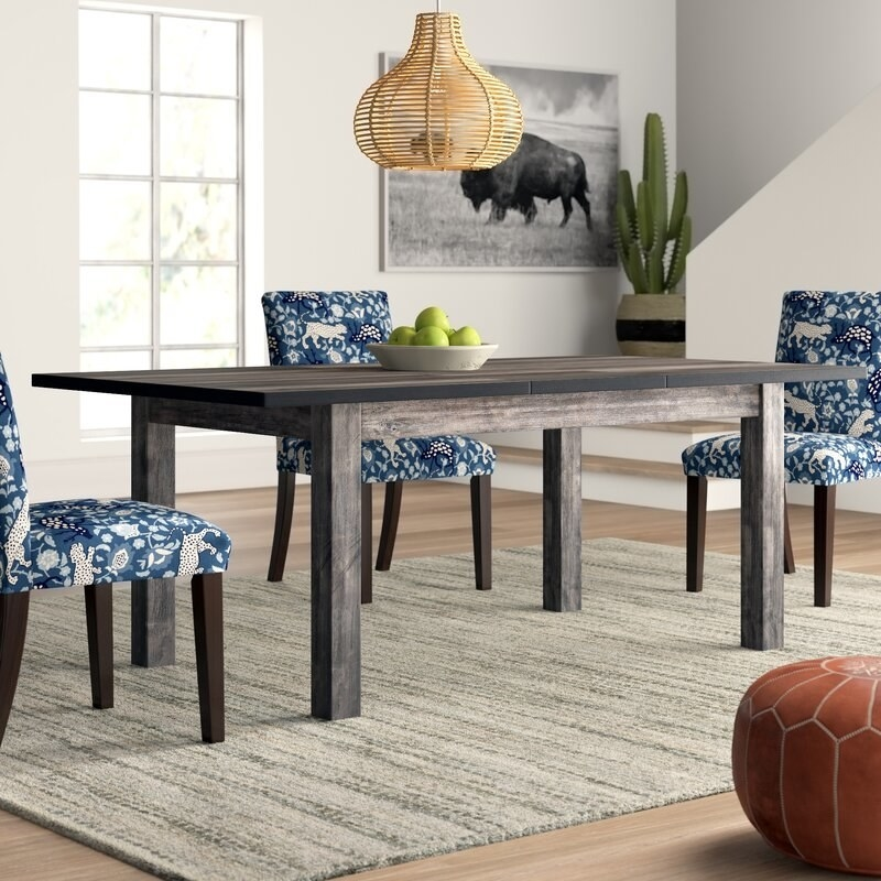 The distressed wood dining table