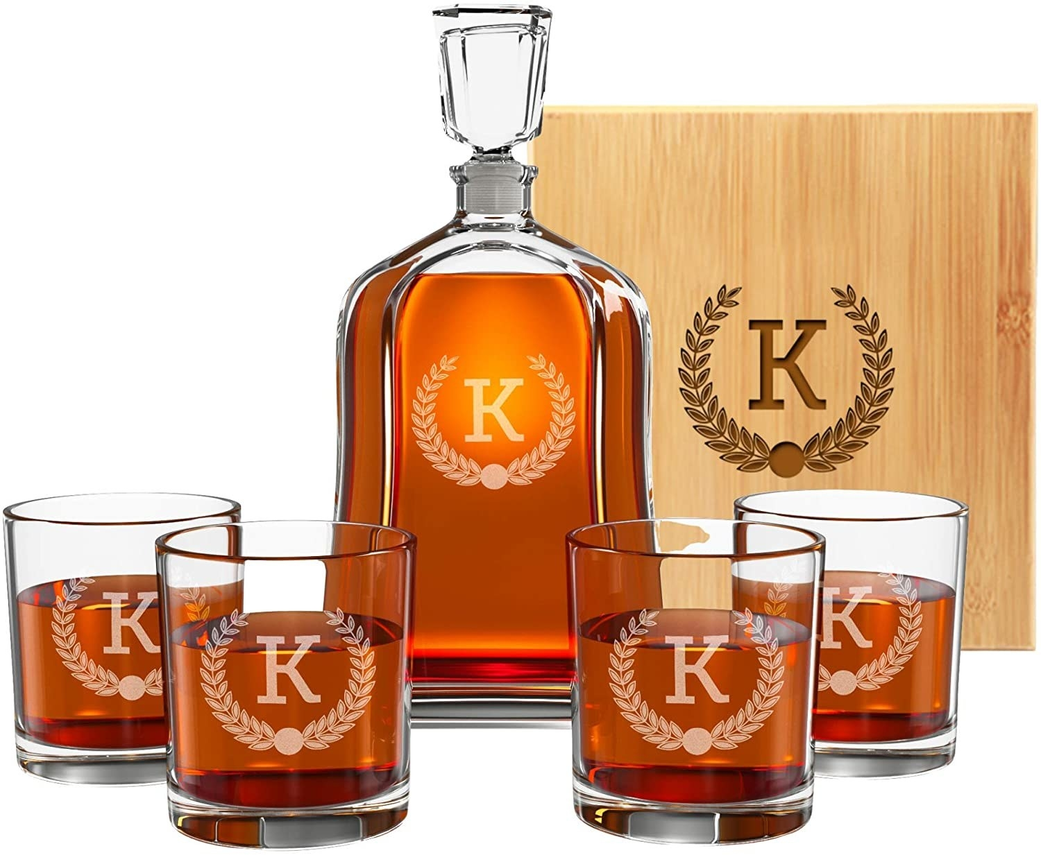 Monogrammed whiskey decanter set, four monogrammed whiskey glasses and a monogrammed wood box