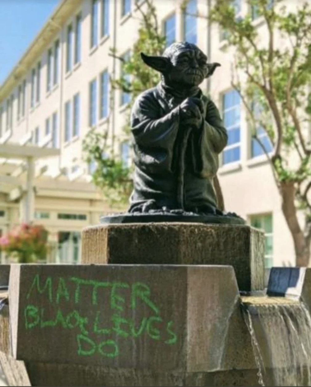 """Matter, black lives do"" has been spray-painted on a statue of yoda"