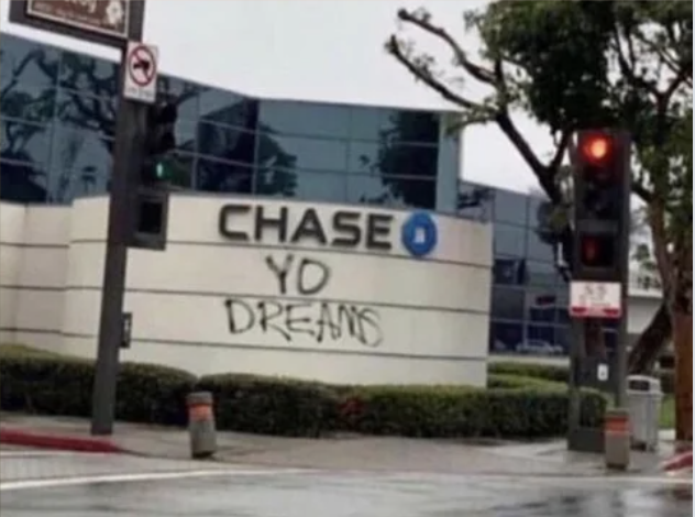 """A Chase bank sign with """"your dreams"""" written under Chase"""
