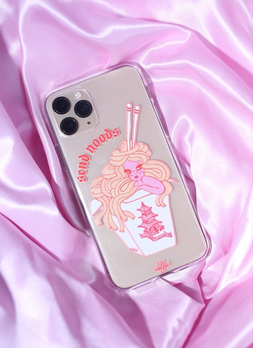 "a phone case with an animated character in a food container with noodles for hair and the words ""send noods"" on above it"