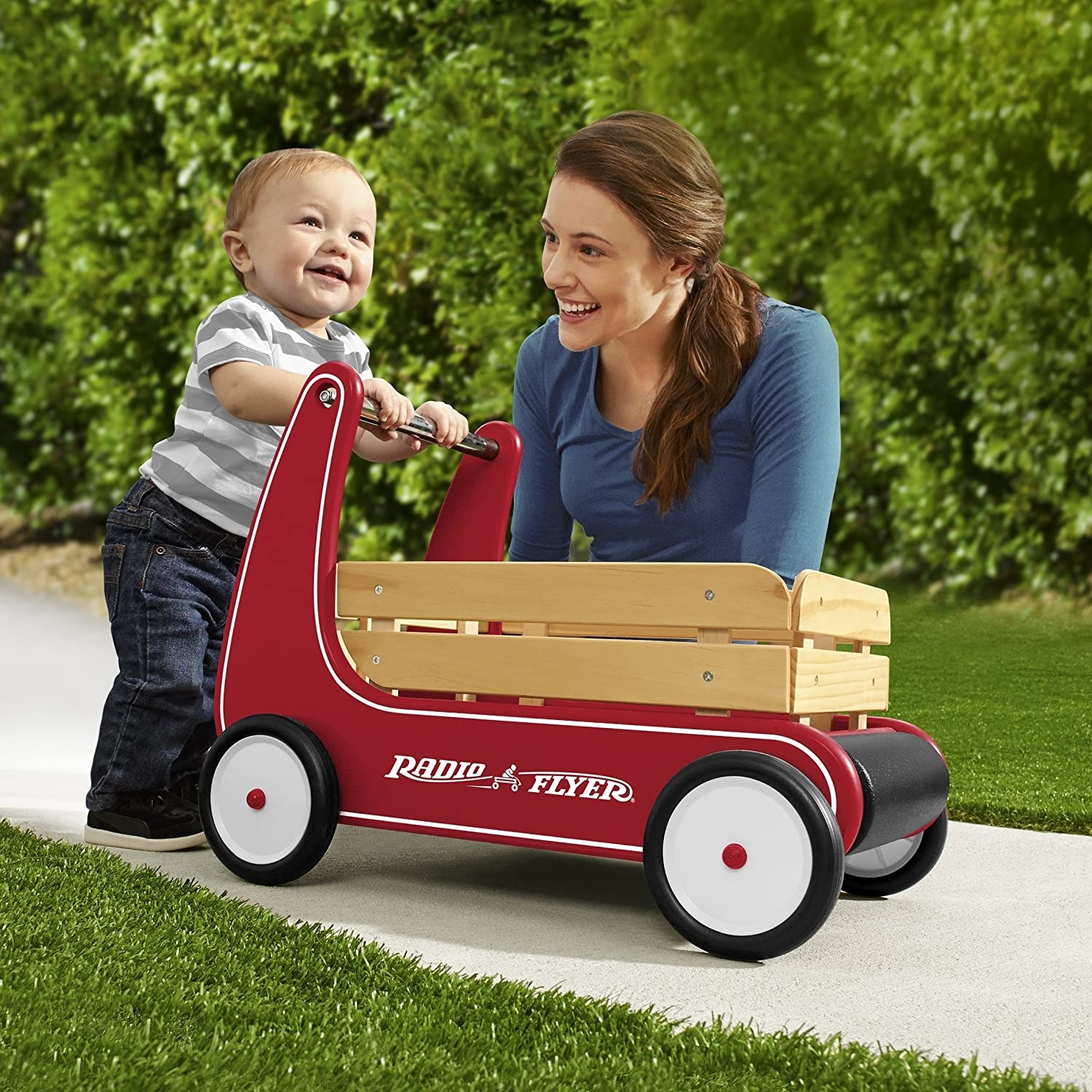 Model and child playing with red radio flyer wagon with side wood paneling