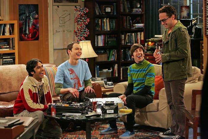 Raj, Sheldon, Howard, and Leonard laughing in Sheldon's living room
