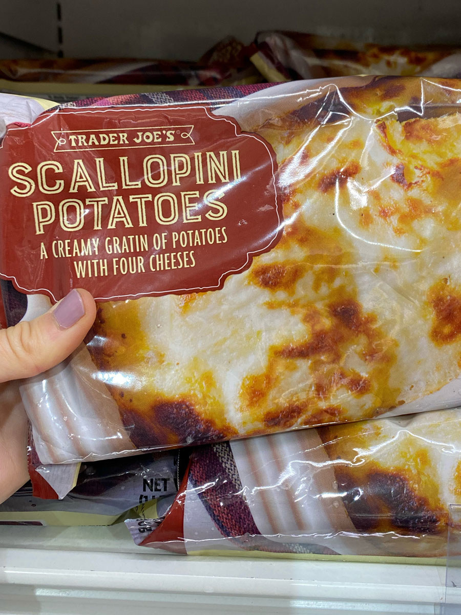 A bag of scallopini potatoes topped with four cheese gratin.