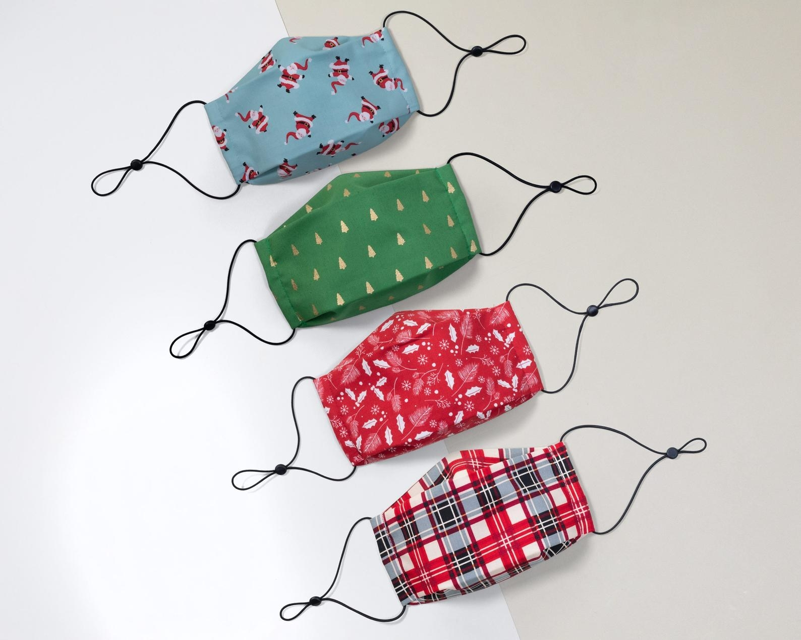 Masks in santa, christmas tree, holly, and plaid prints