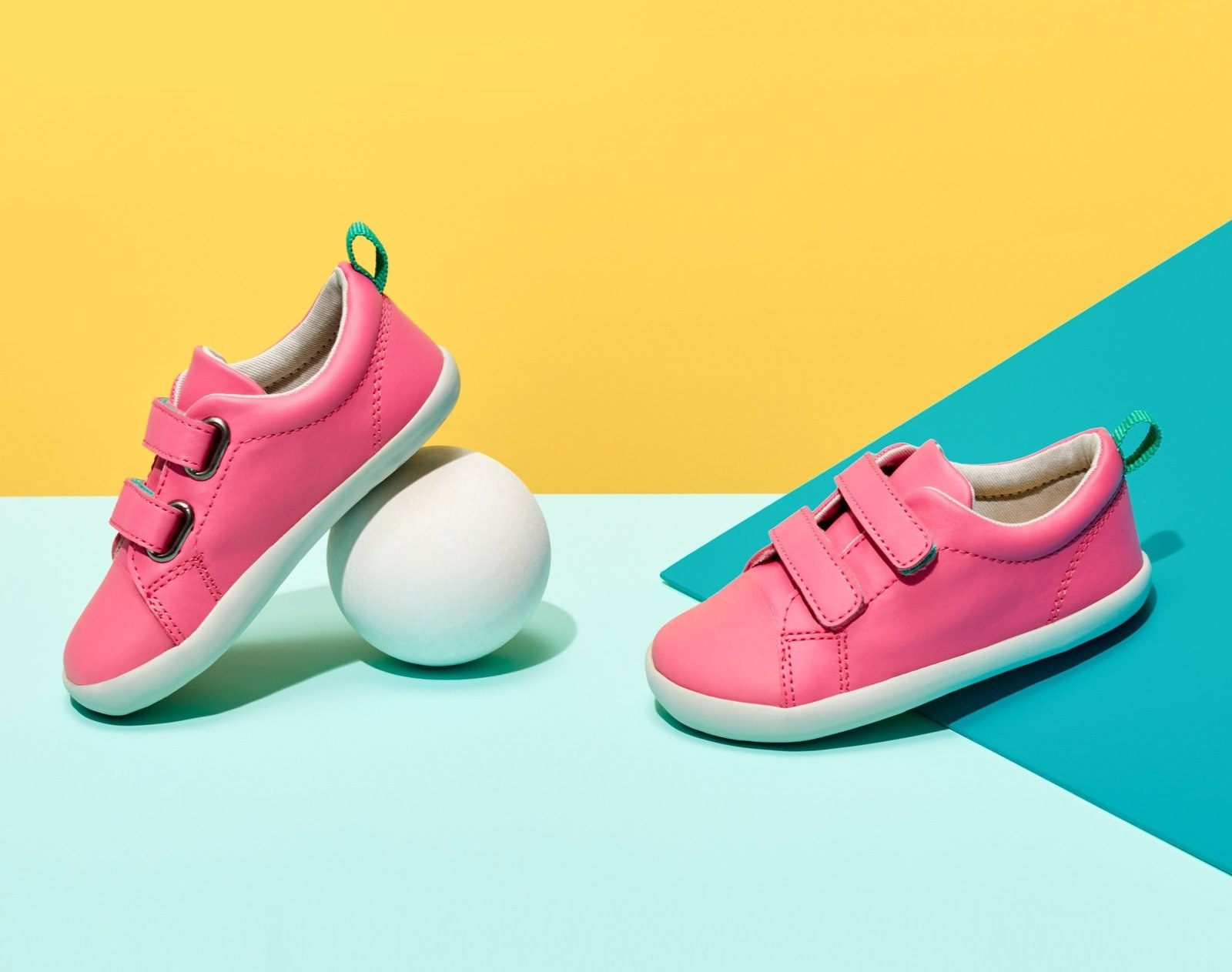 Pink sneakers with velcro straps and white treads