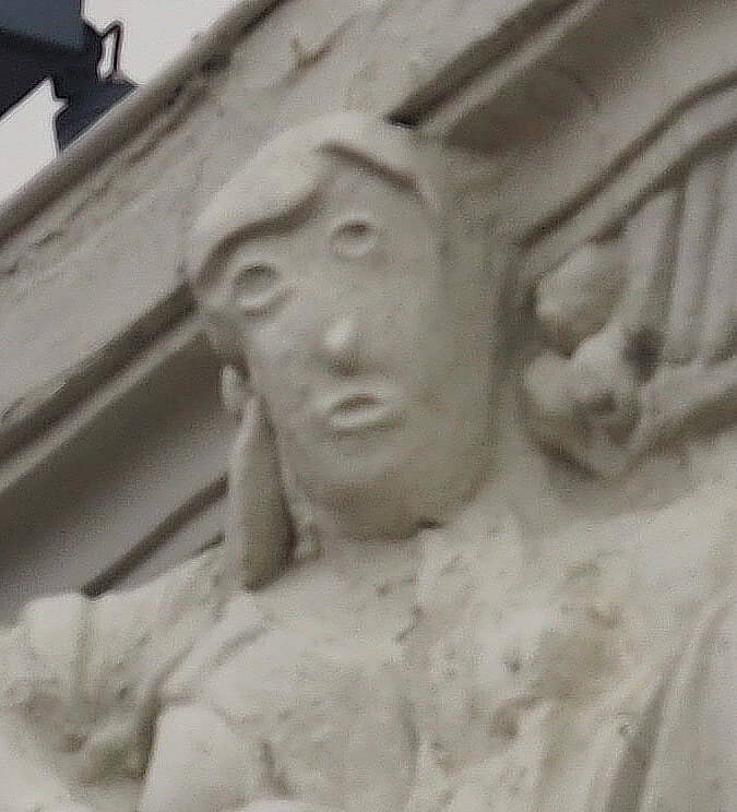 The face of a sculpture that was restored incredibly poorly