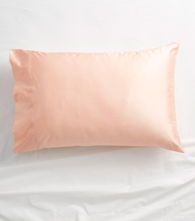 silk pillow on a bed