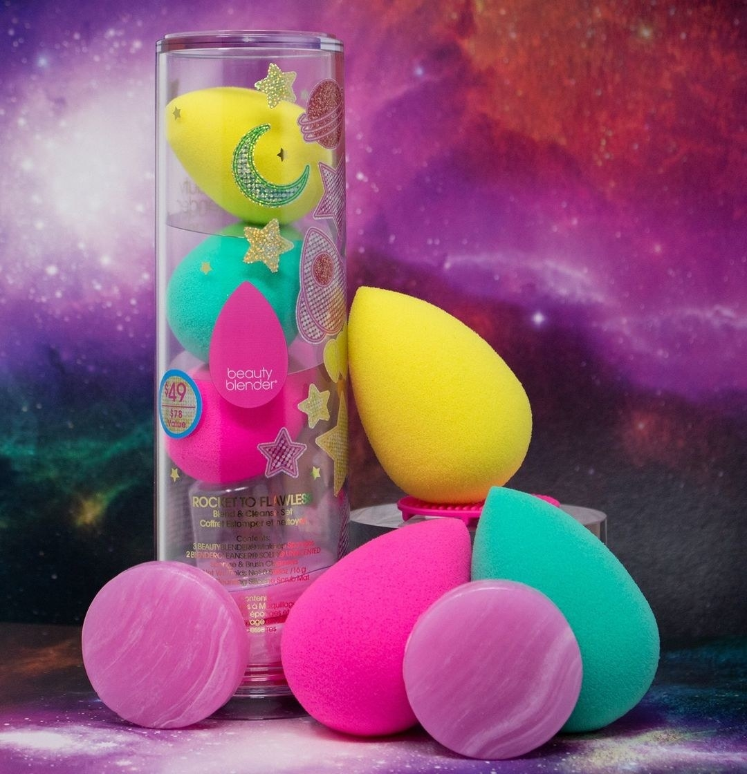 The set of three beauty sponges, two solid cleansers and the cleansing mat against a cosmic backdrop