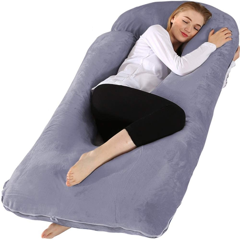 A model using the body pillow in purple grey