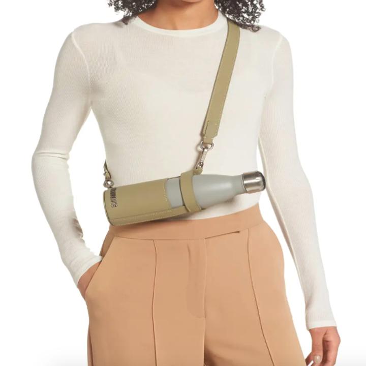 A model wearing the crossbody water bottle holder.