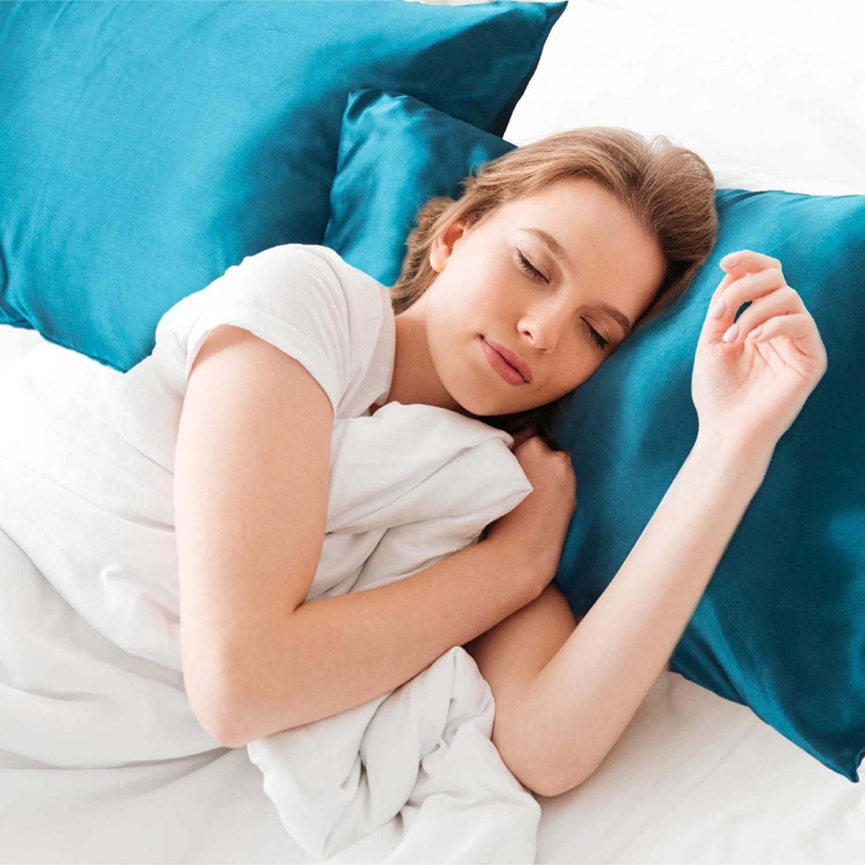 Model sleeping on a satin pillowcase