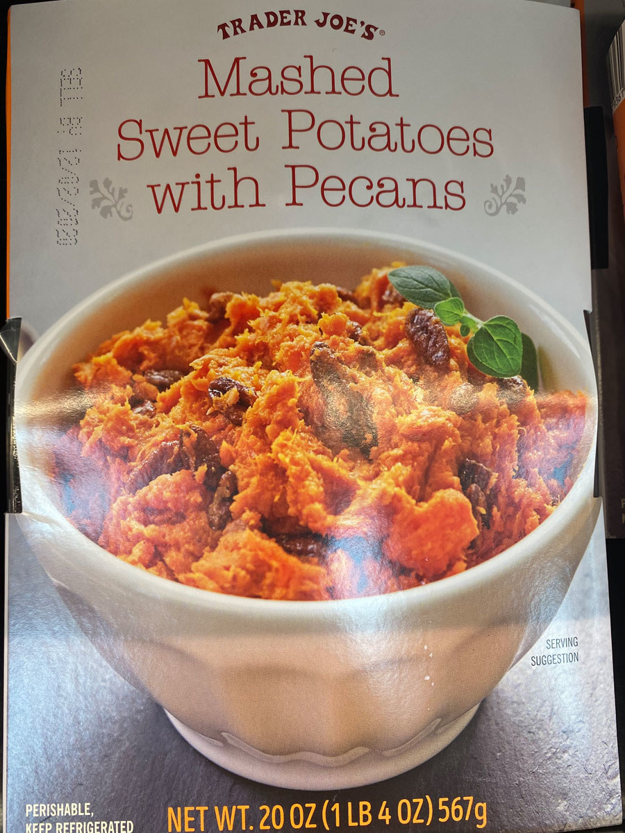 A box of sweet potatoes with pecans.