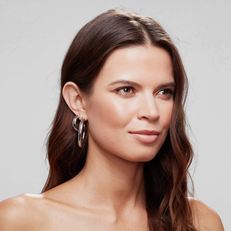 model wearing the hoop earrings
