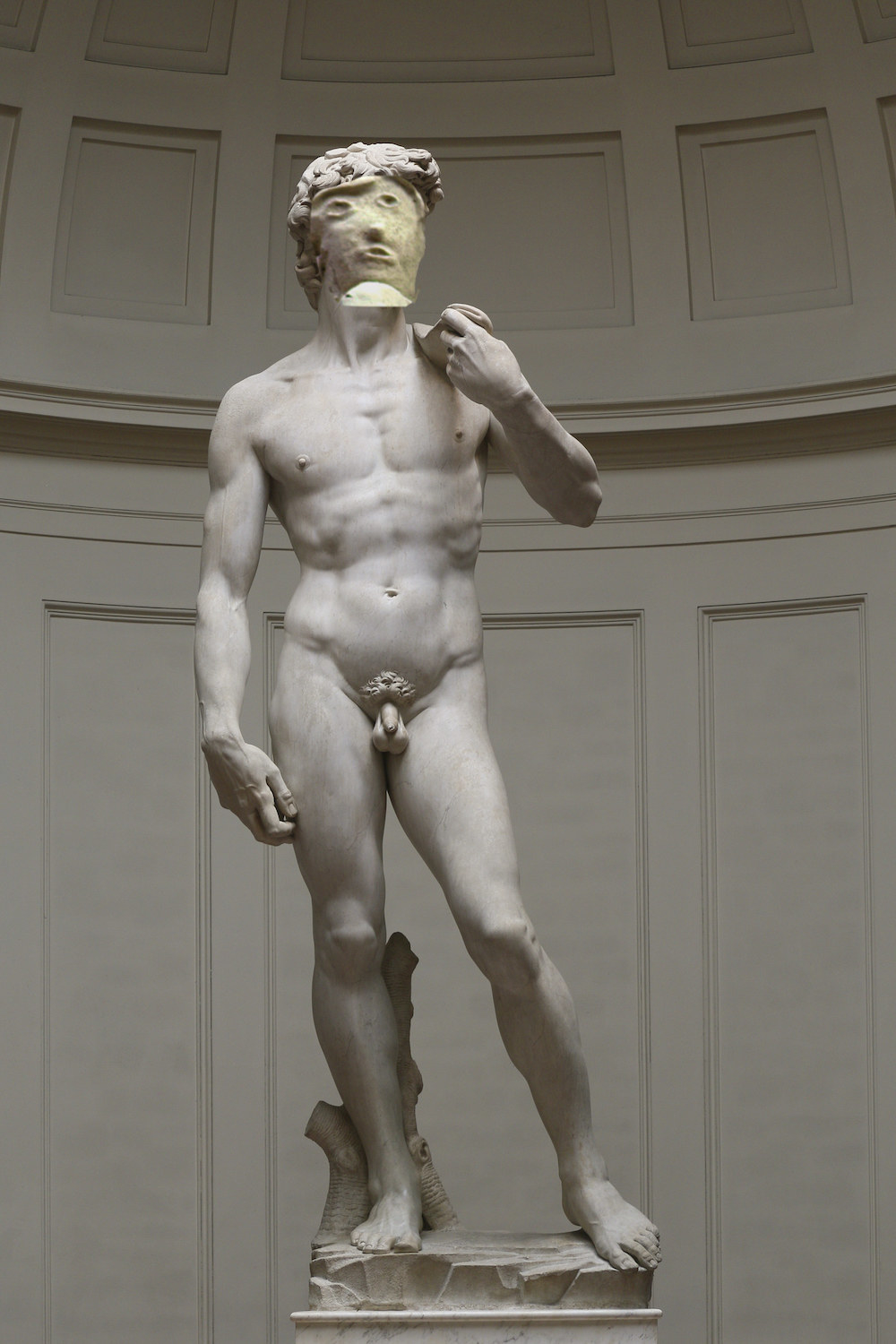 The sculpture's restored face superimposed on the face of Michelangelo's David sculpture