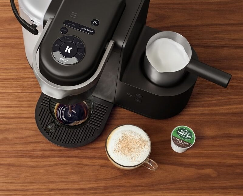 A Keurig coffee maker with milk frother