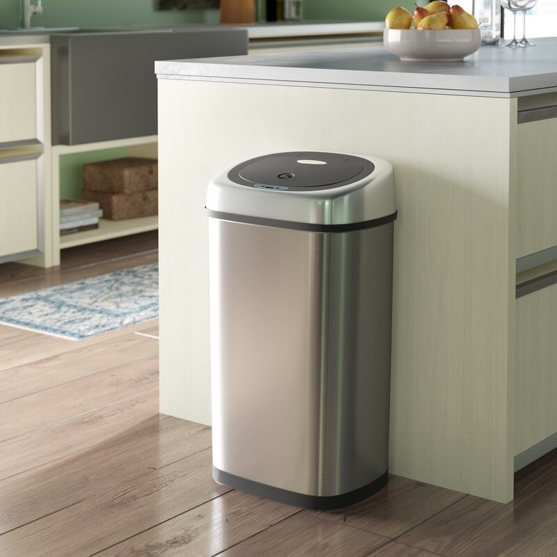 A stainless steel trash can with motion sensor lid