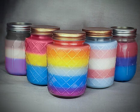 a variety of layered pride-themed candles