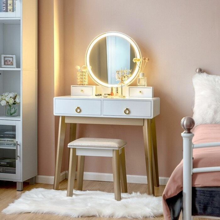 white vanity set with gold legs, also stools and light-up mirrors