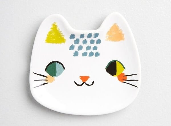 the trinket tray with a cat face painted on it