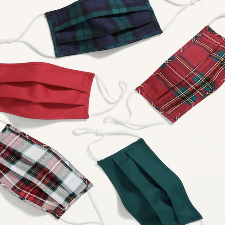 five masks in plaids and solids in dark green and red