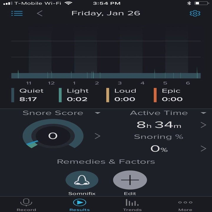A reviewer's photo of their sleep tracker which shows a zero snore score after using the strips