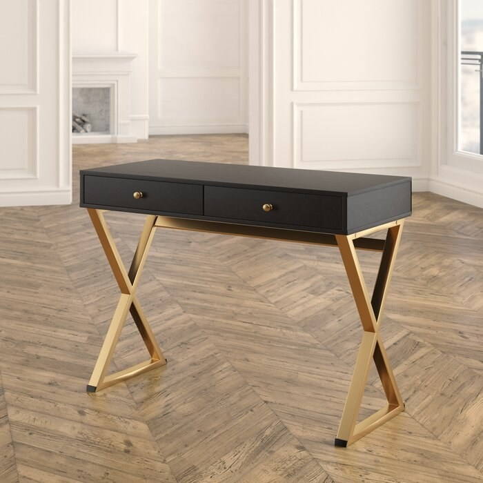 black and gold writing desk in the middle of the room
