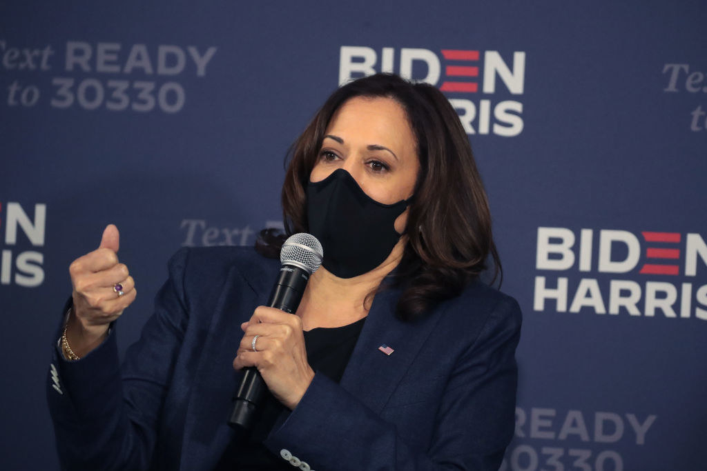 Harris speaking with a mask on