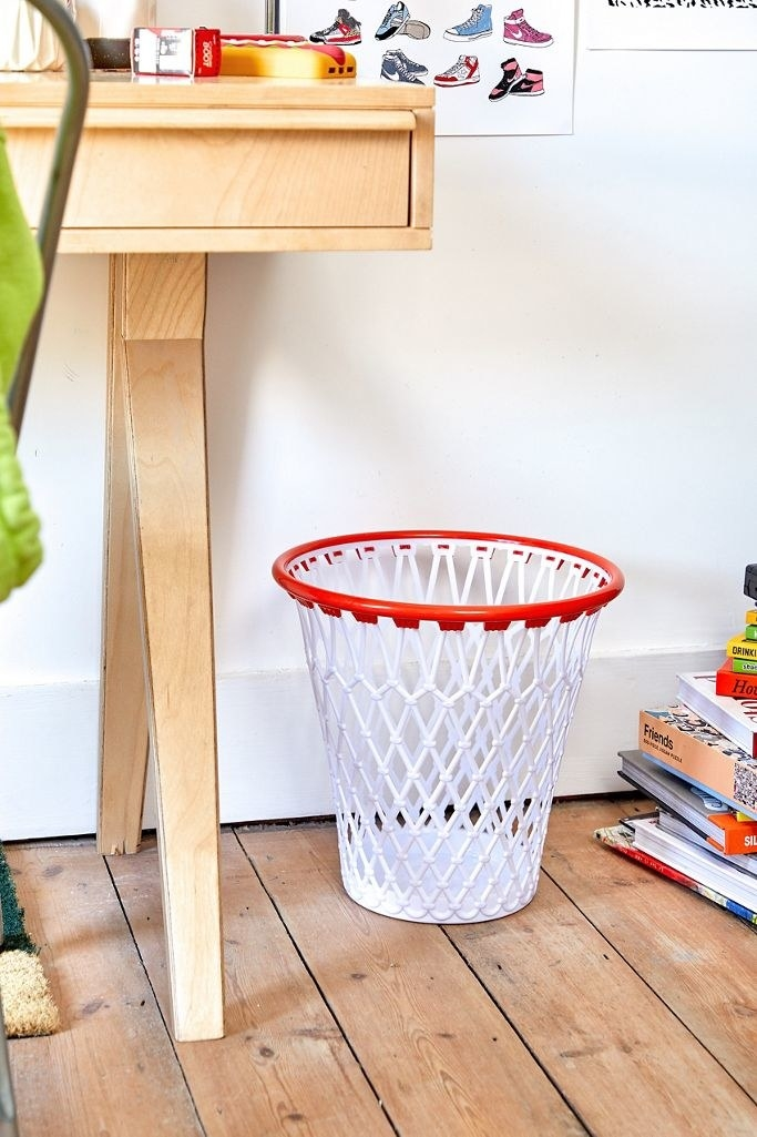 the basketball bin on the floor of a bedroom