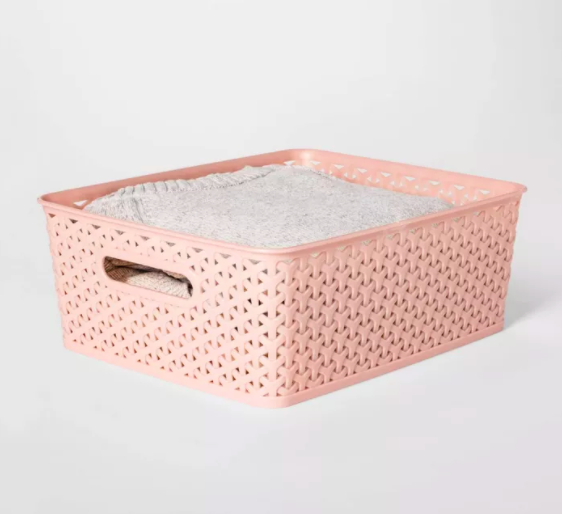 the woven pink rectangle bin storing sheets