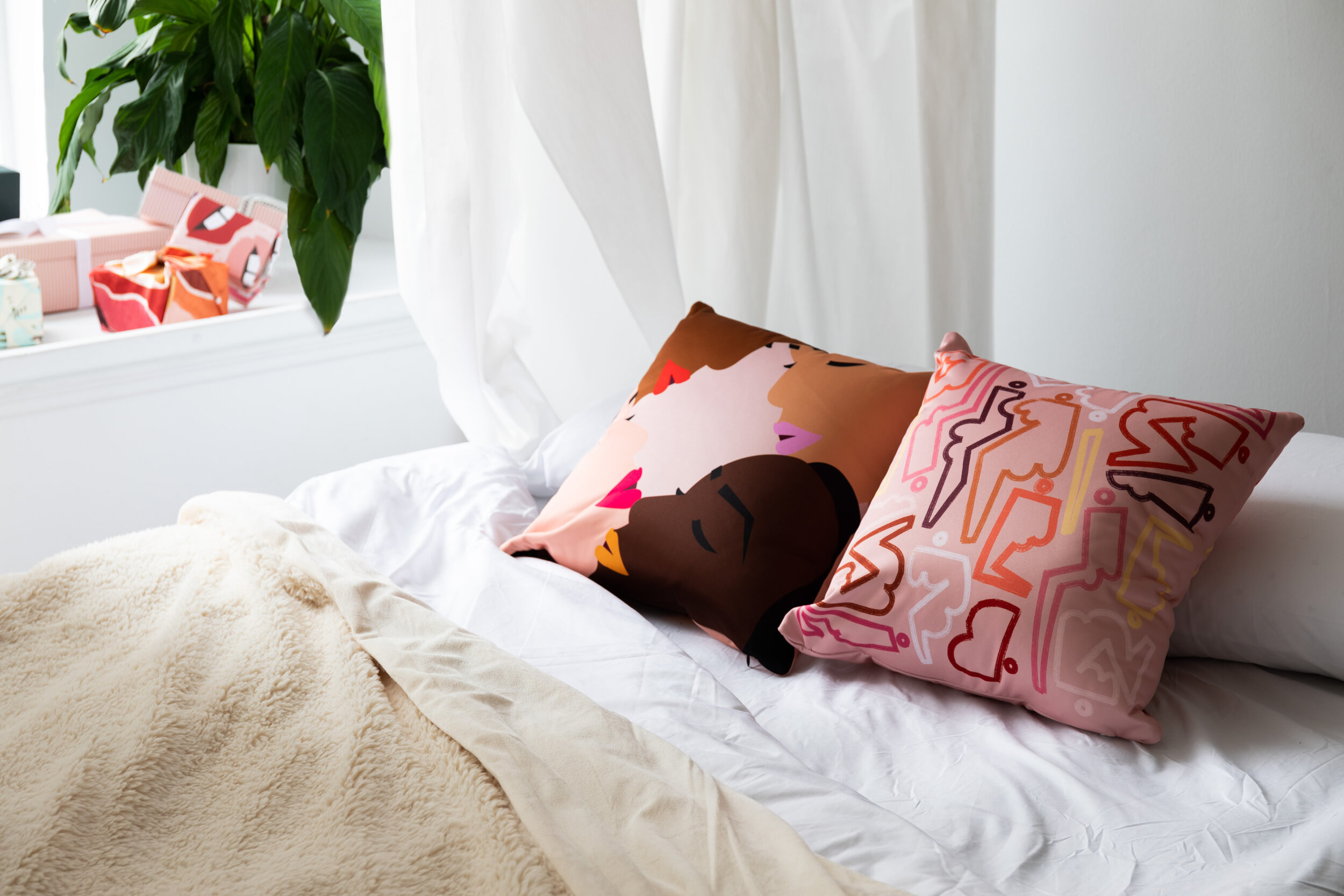 Throw pillows styled on bed