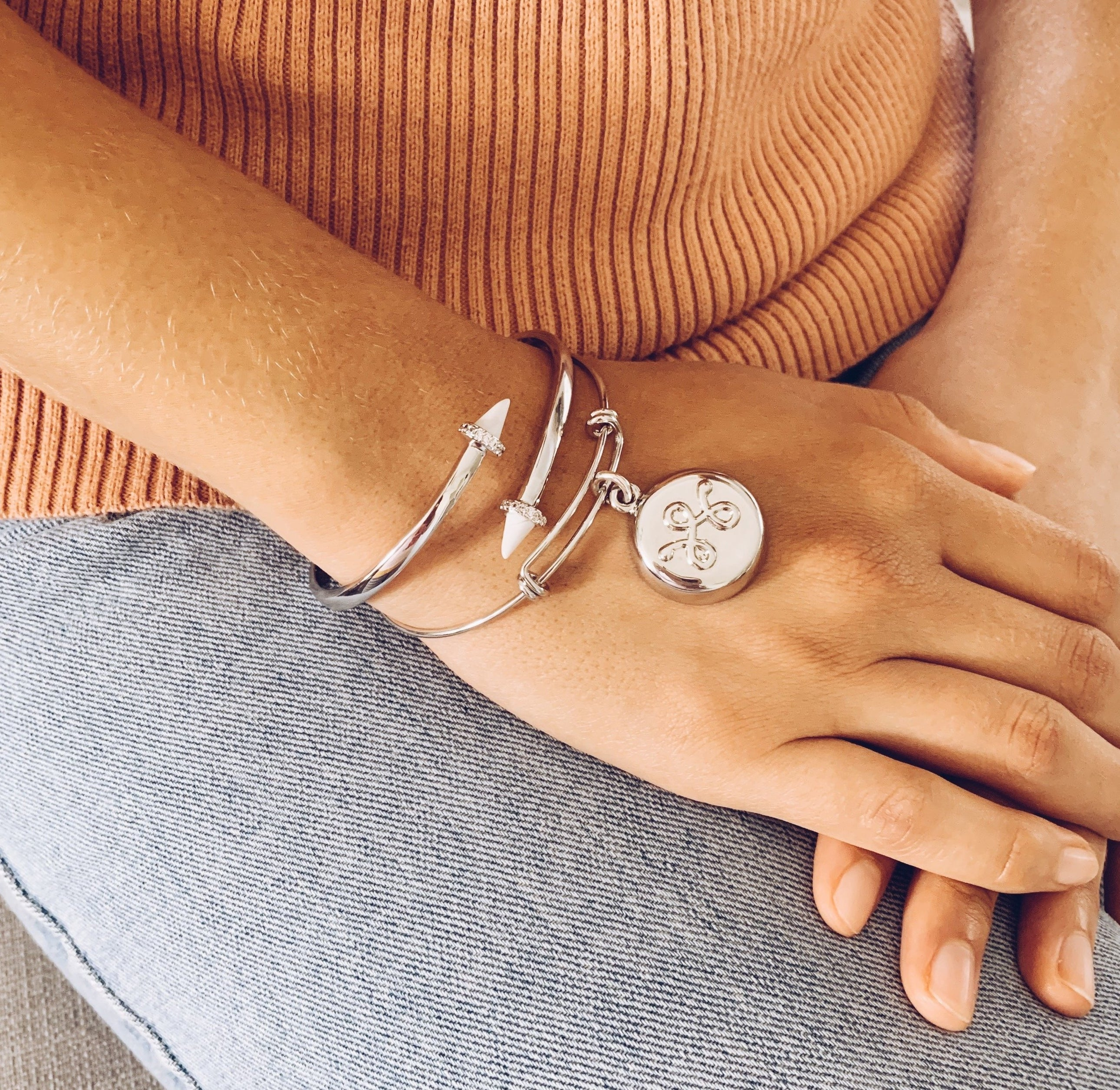 model wearing silver expandable bracelet