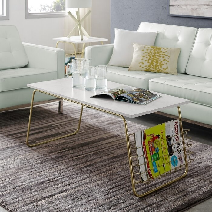 coffee table with faux white marble top and gold base