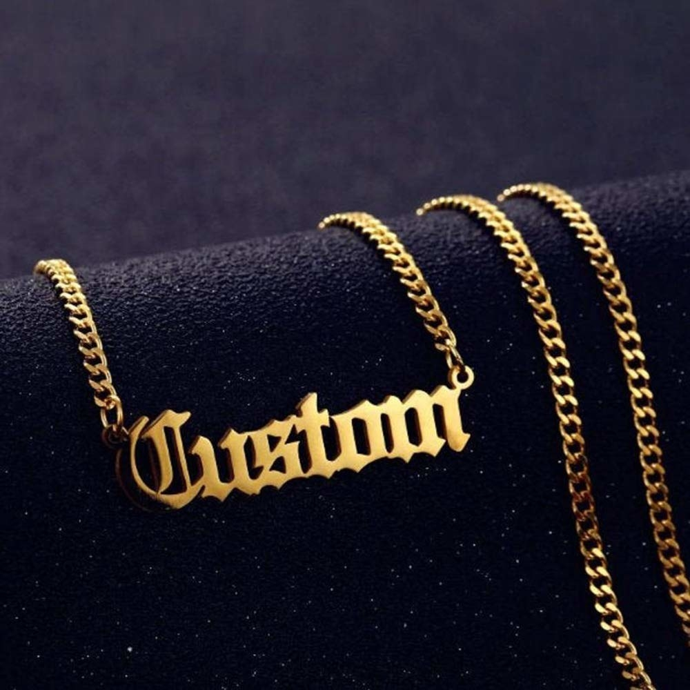 gold colored chain with charm that says custom