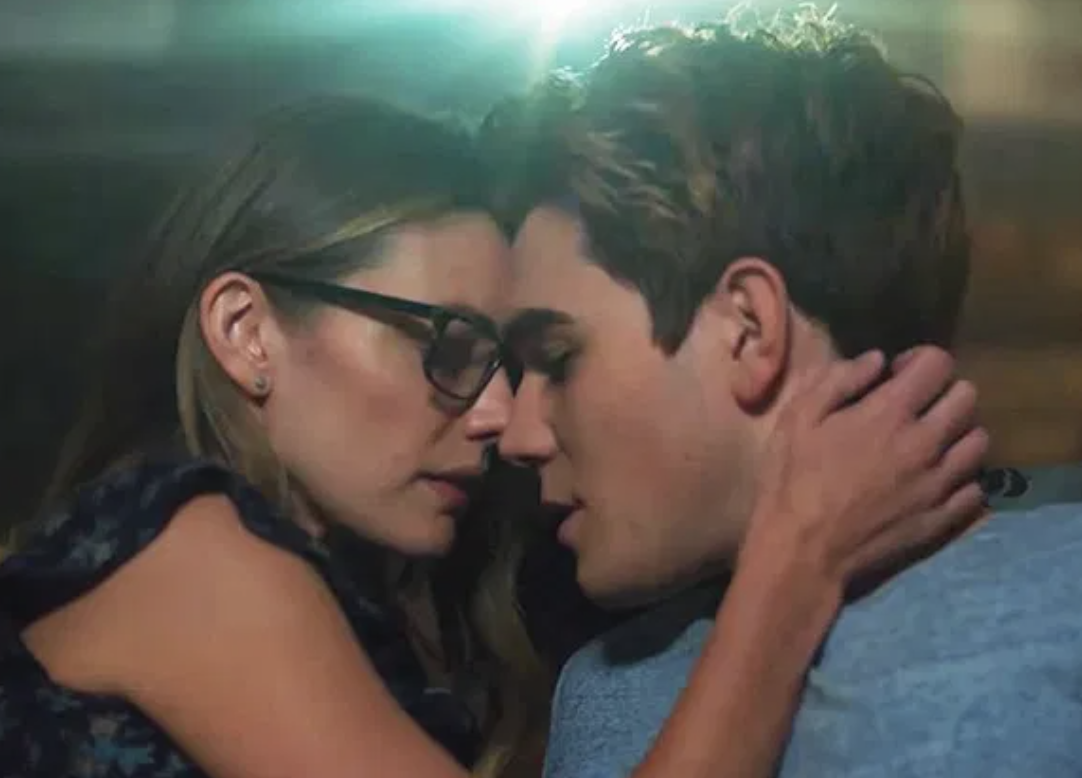 Archie and Ms. Grundy about to kiss.