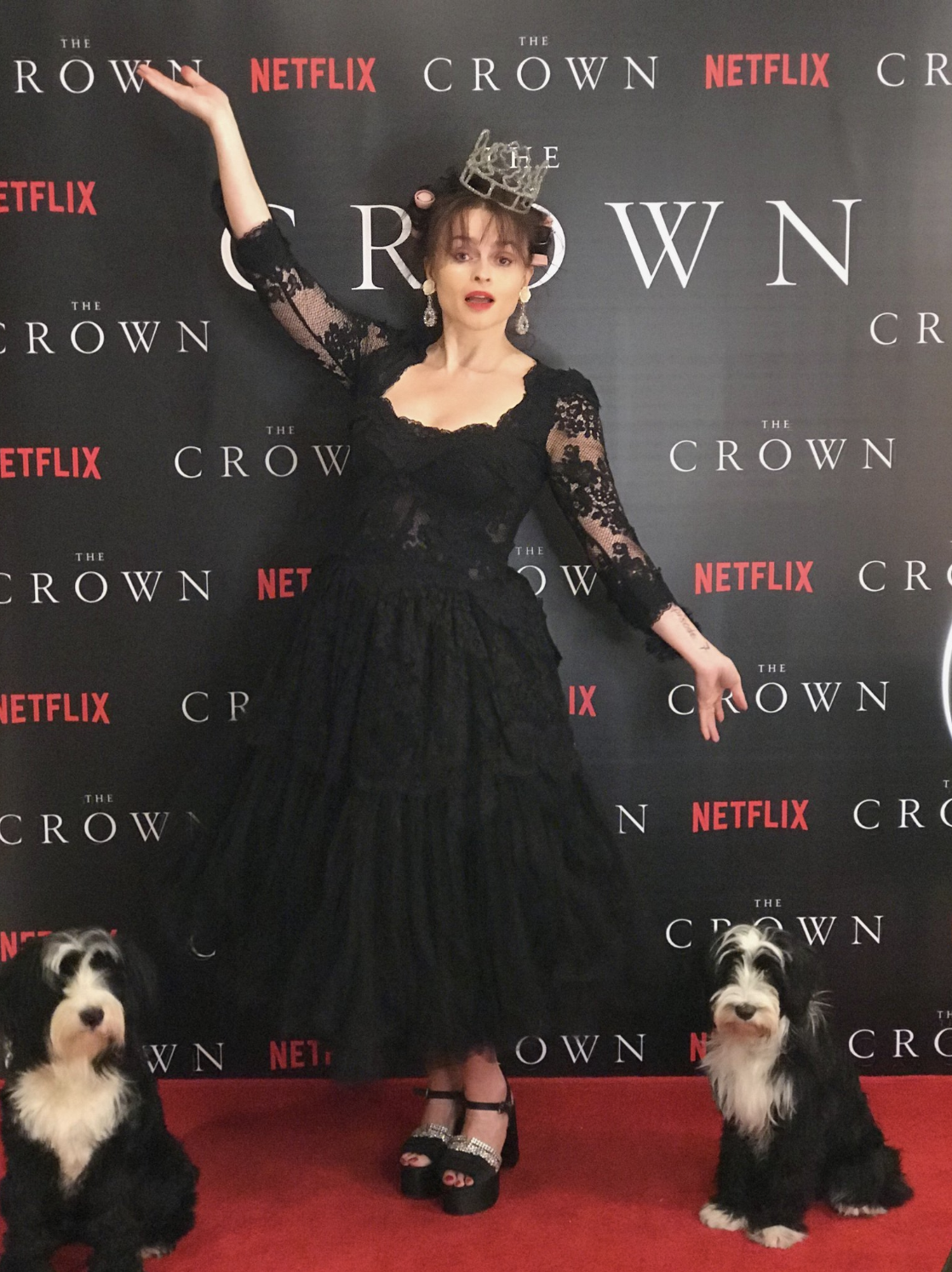 """Helena Bonham Carter with her arms raised as if to say, """"ta-da!"""""""