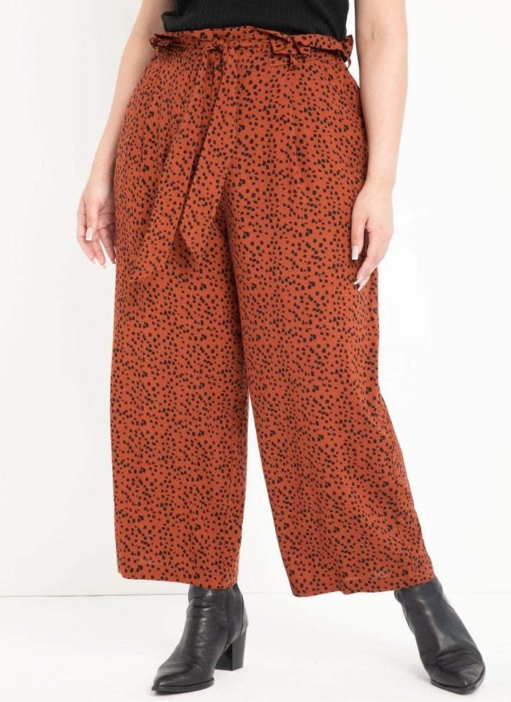 model wears dotted wide leg paperbag waisted pants