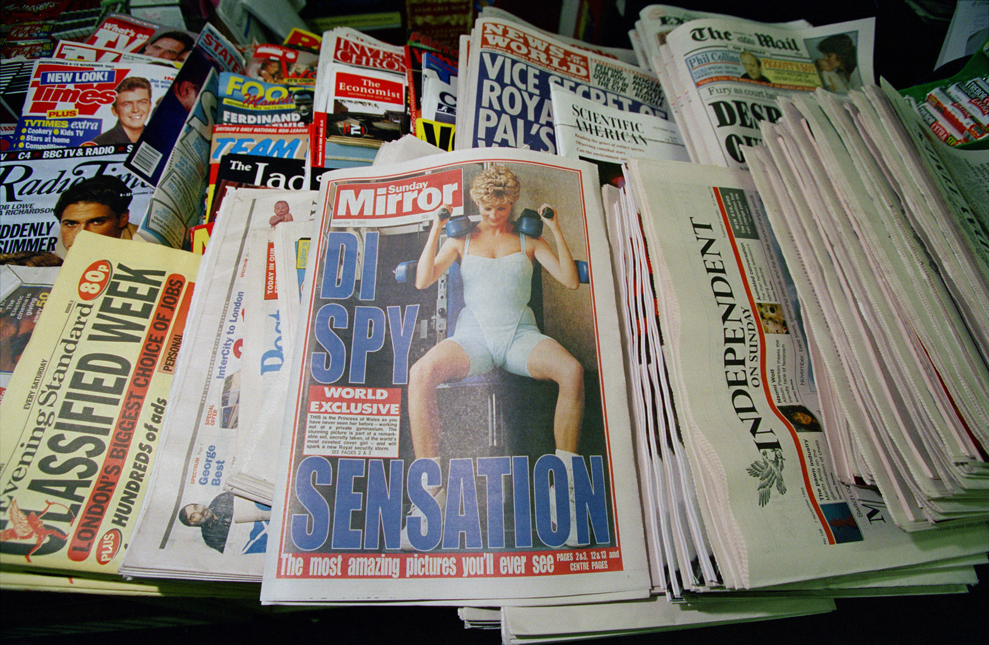 At the center is a copy of the Sunday Mirror, featuring a controversial, secretly taken picture of Diana, Princess of Wales