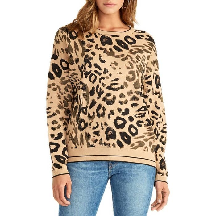 model wears tan and black leopard print pullover