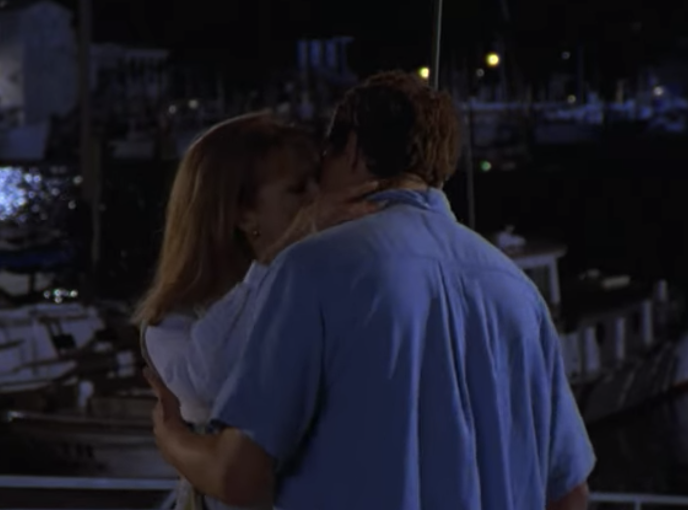 Pacey and Tamara kissing on a dock.