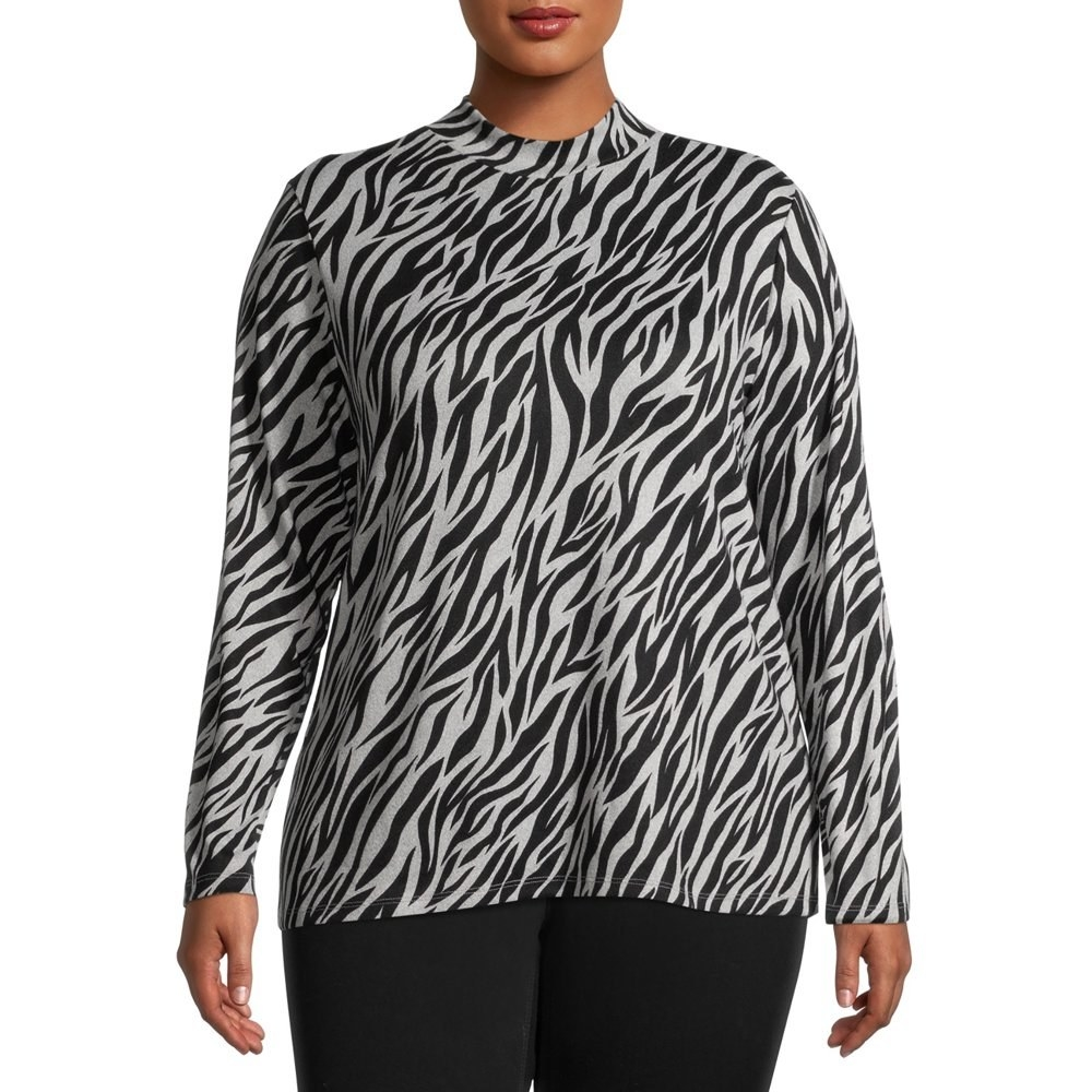 model wears black and white mock neck zebra shirt