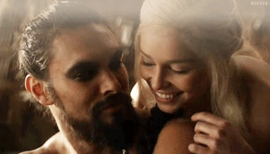 Daenerys and Khal Drogo smiling while she embraces him.