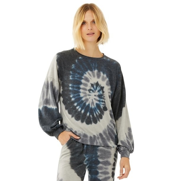 model wears black gray and blue tie dye sweatshirt