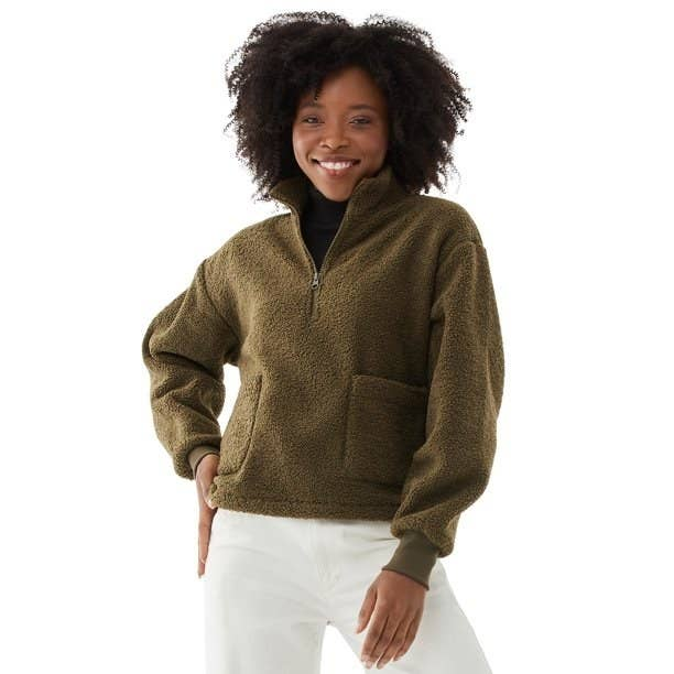 model wears green sherpa pullover