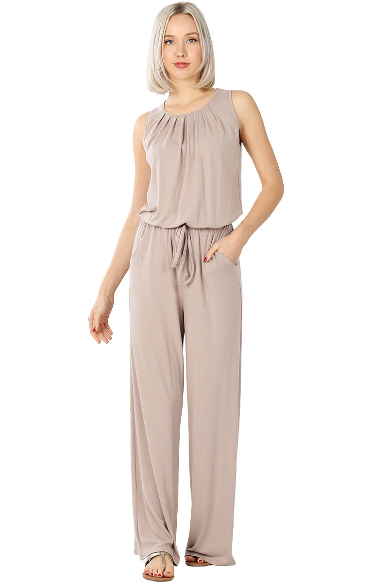 model wears sleeveless tan colored jumpsuit