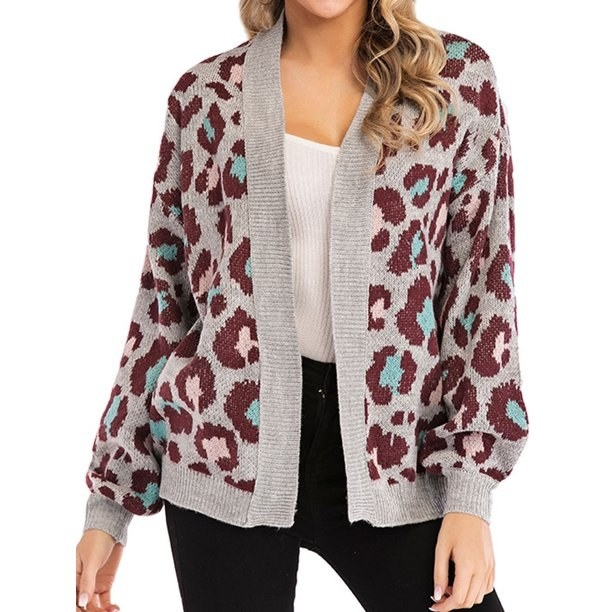 model wears purple leopard print patterned gray cardigan sweater